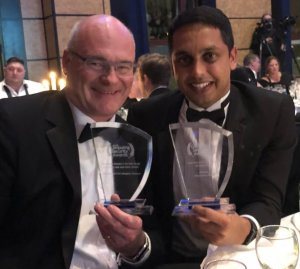 Mike Fenton and Gubi Singh with awards