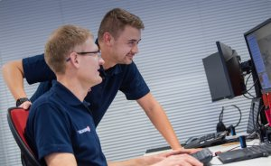 Two Redscan team members analysing cyber security intelligence